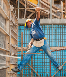 construction worker standing on scaffolding before being injured at work and needing a workers compensation attorney