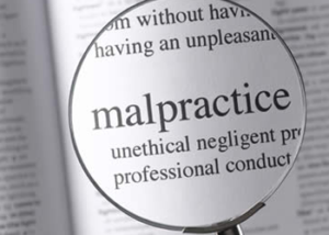 malpractice in a dictionary with a magnifying glass as represented by malpractice attorneys at nalder law office in idaho falls